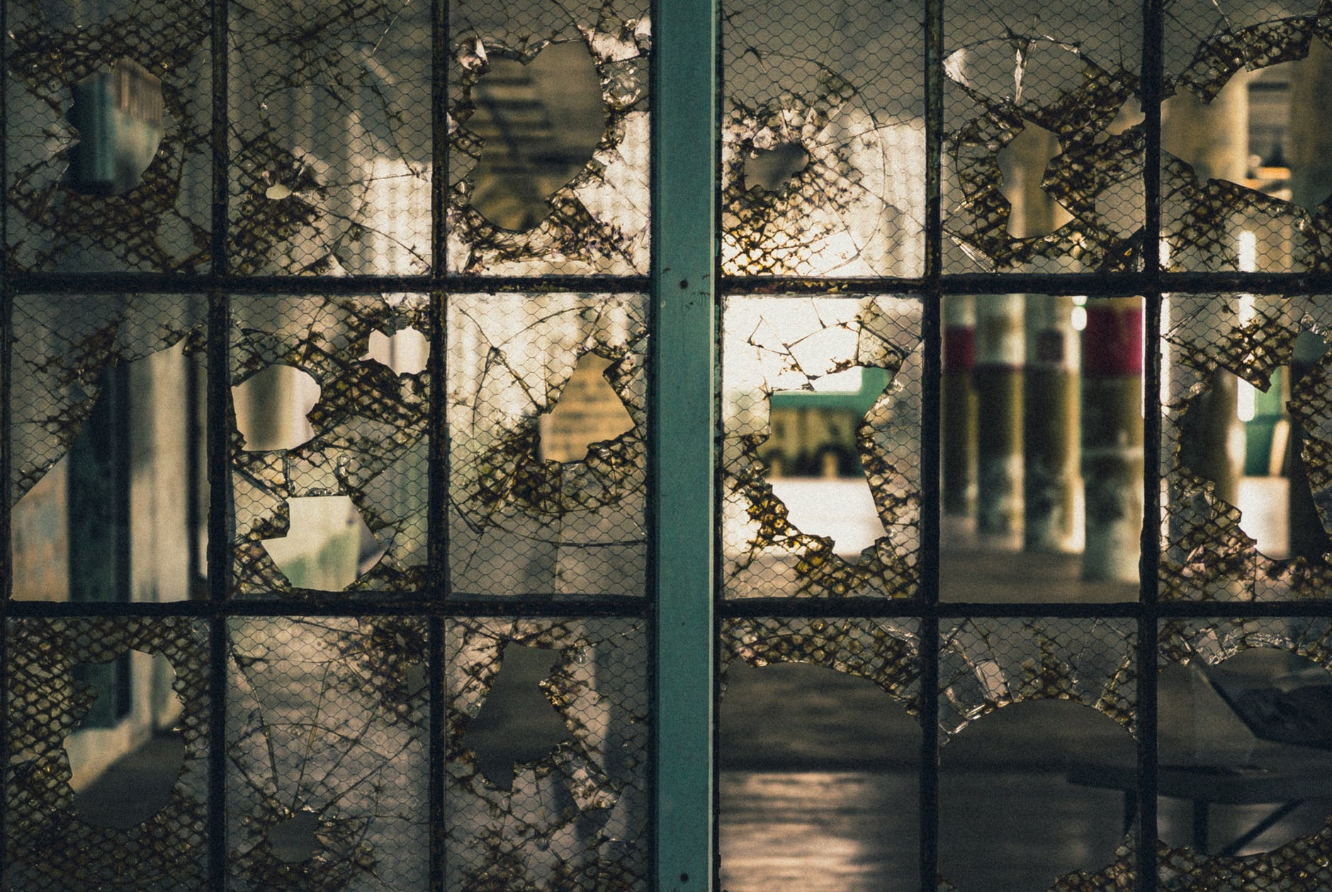 broken glass window with gray metal frame