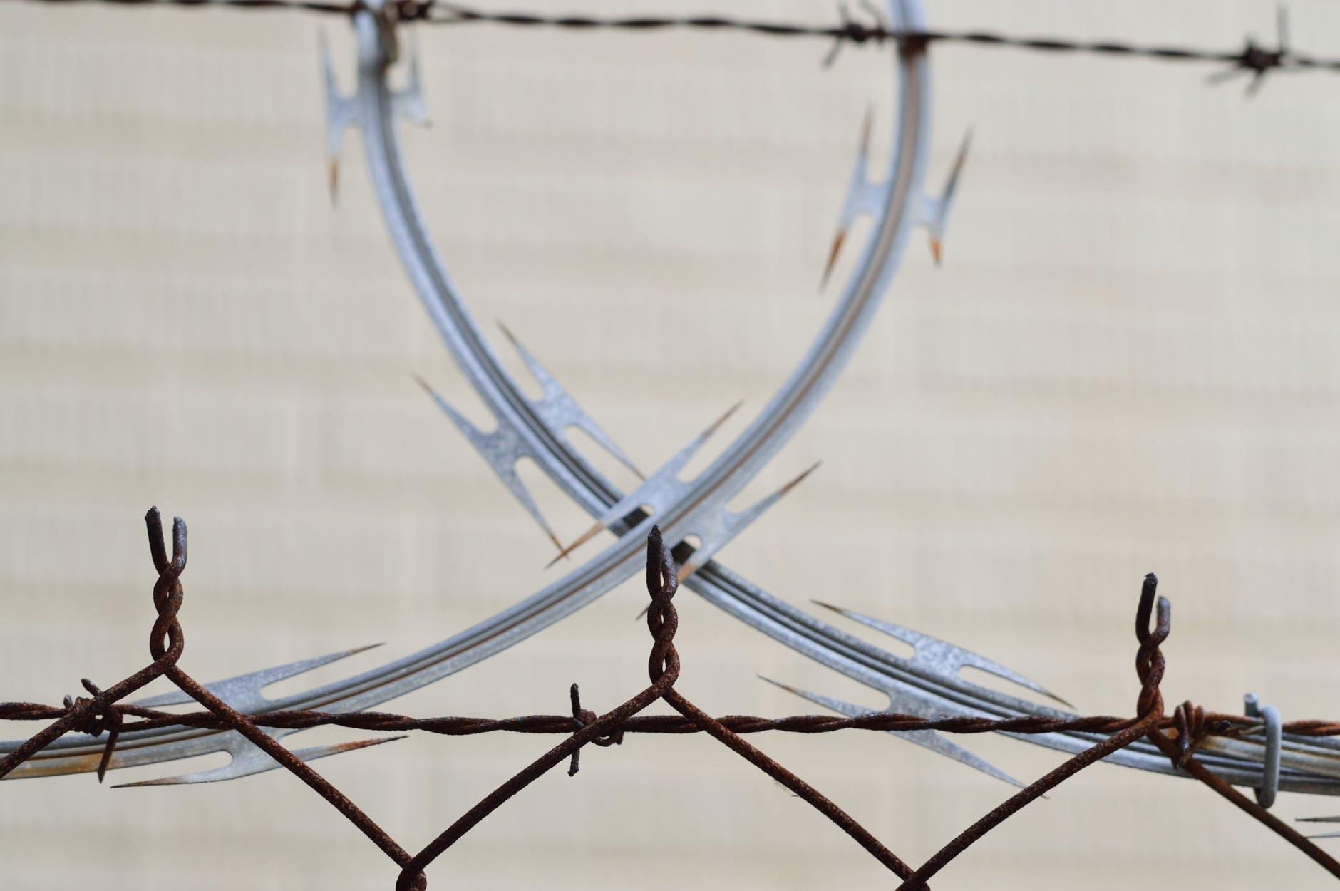 barbed wire barrier blur border