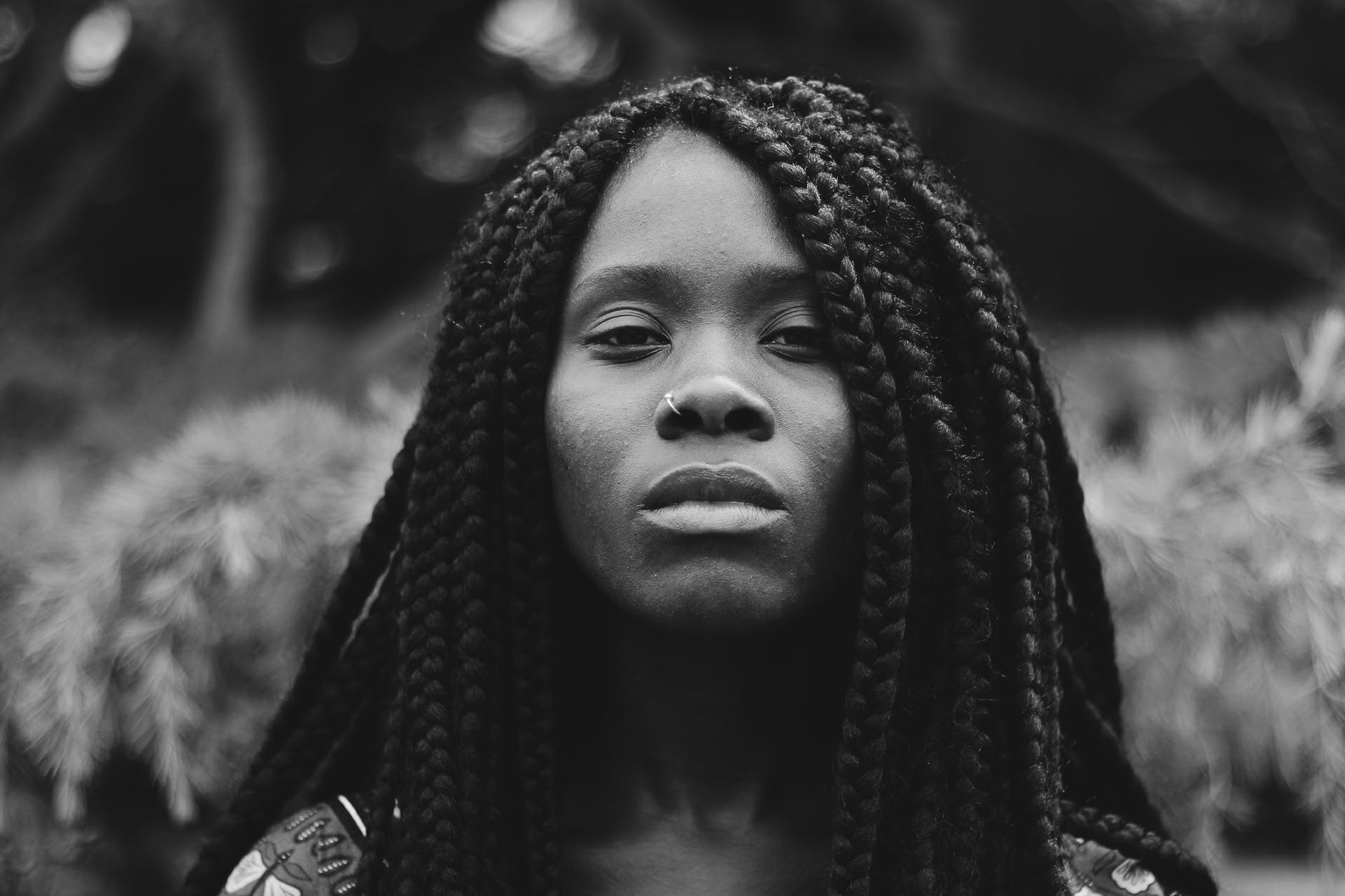 grayscale photo of braided hair woman